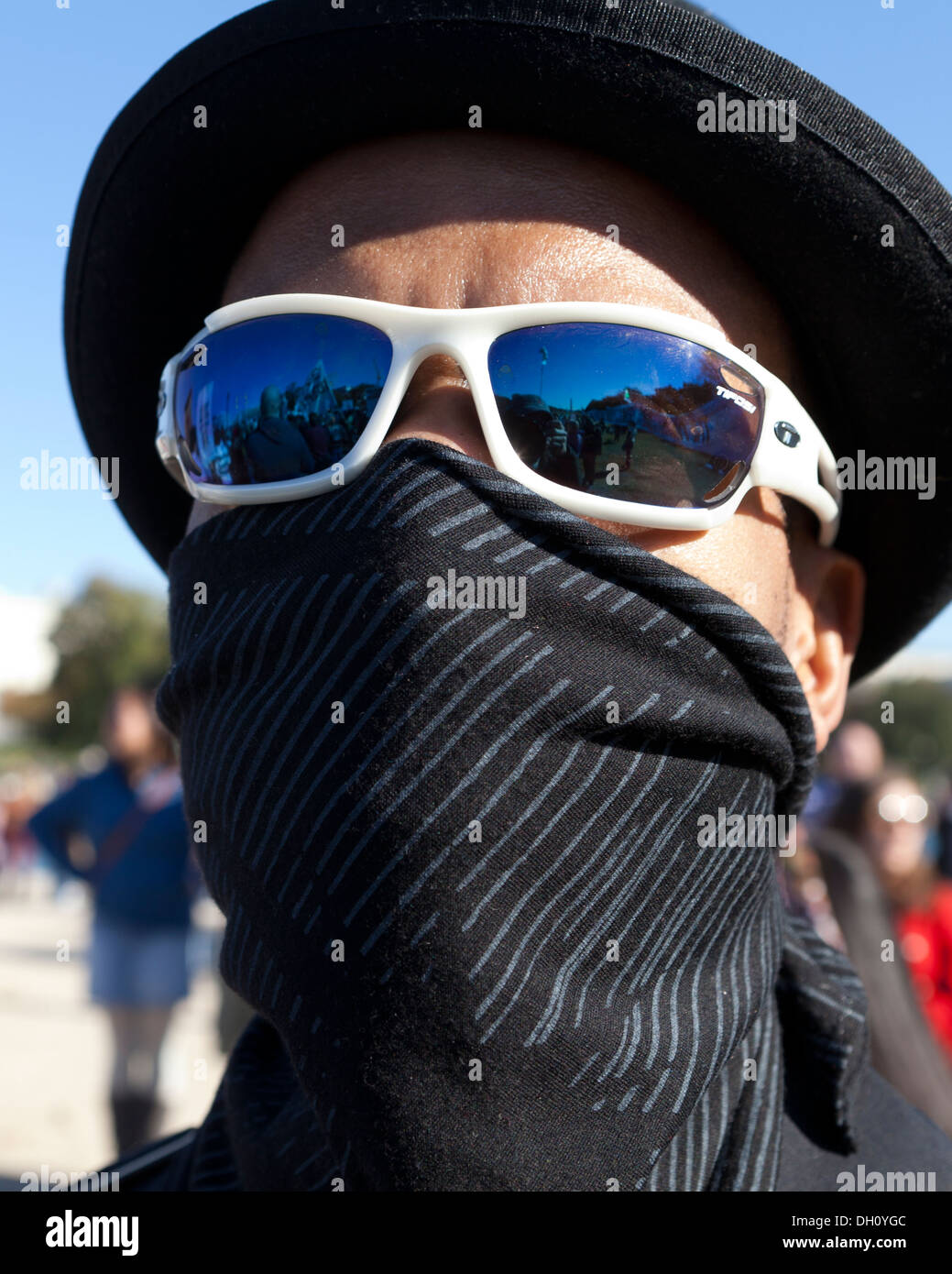 Man Hiding Face With Bandana Mask Sunglasses And Hat In Protest Rally