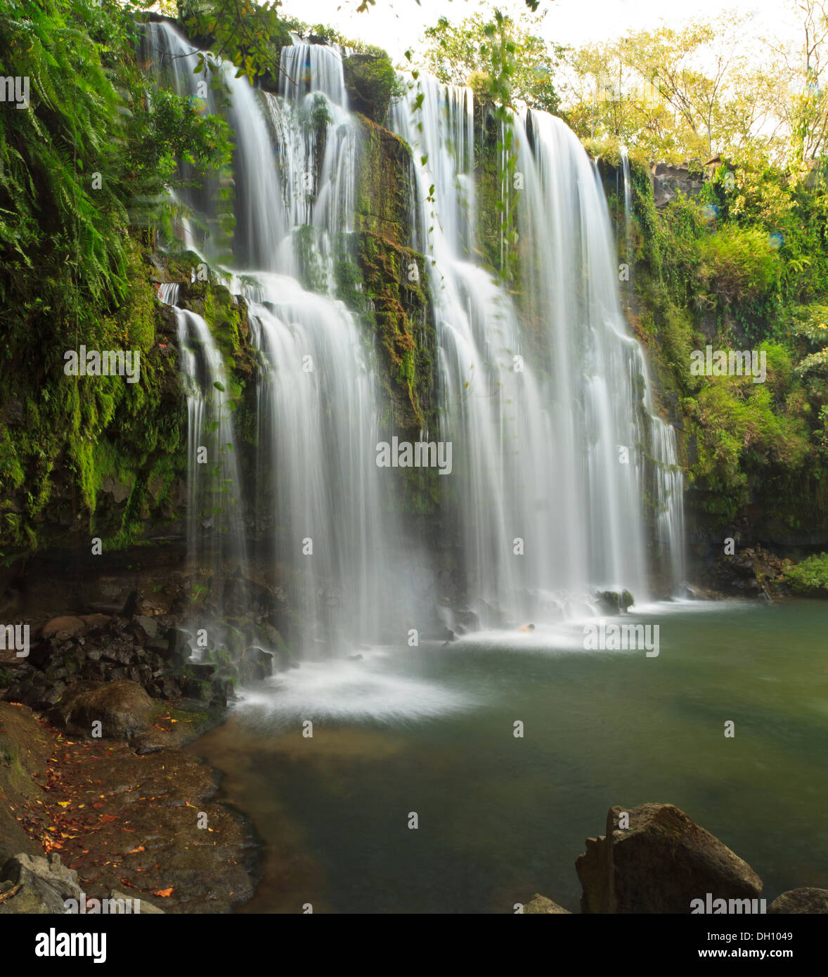 Side view of the idyllic and silky Llano de Cortes waterfall near Bagaces, Costa Rica - Stock Image