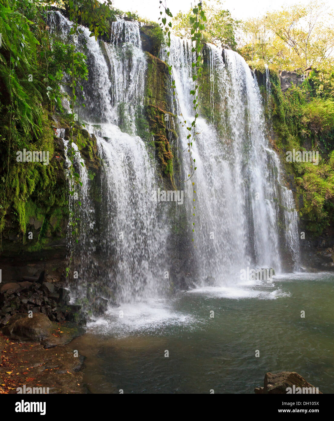 Side view of the idyllic Llano de Cortes waterfall near Bagaces, Costa Rica - Stock Image
