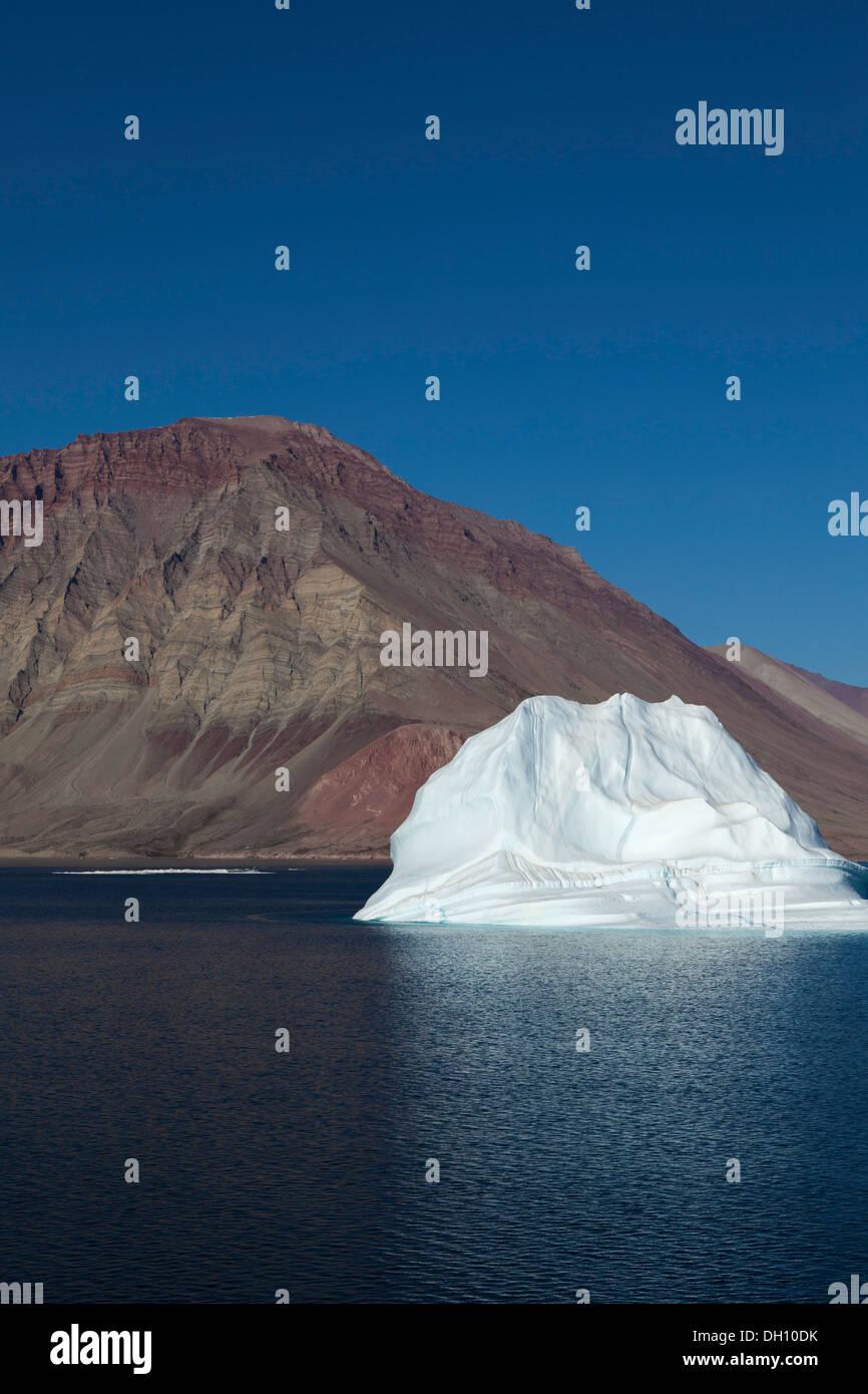 Luminous white iceberg in Kaiser Franz Joseph fjord, Greenland - Stock Image