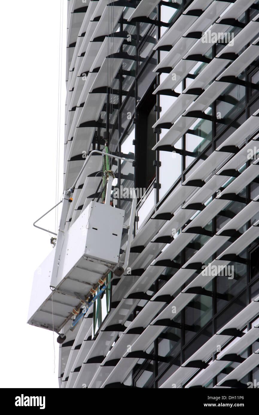 window repairing at a multistorey - Stock Image