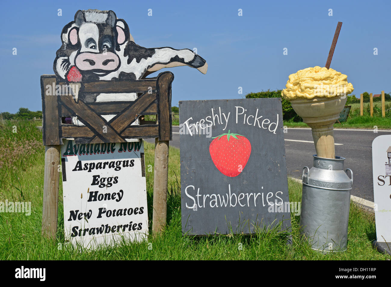 Freshly picked strawberries sign on roadside, Sutton-on-Sea, Lincolnshire, England, United Kingdom - Stock Image