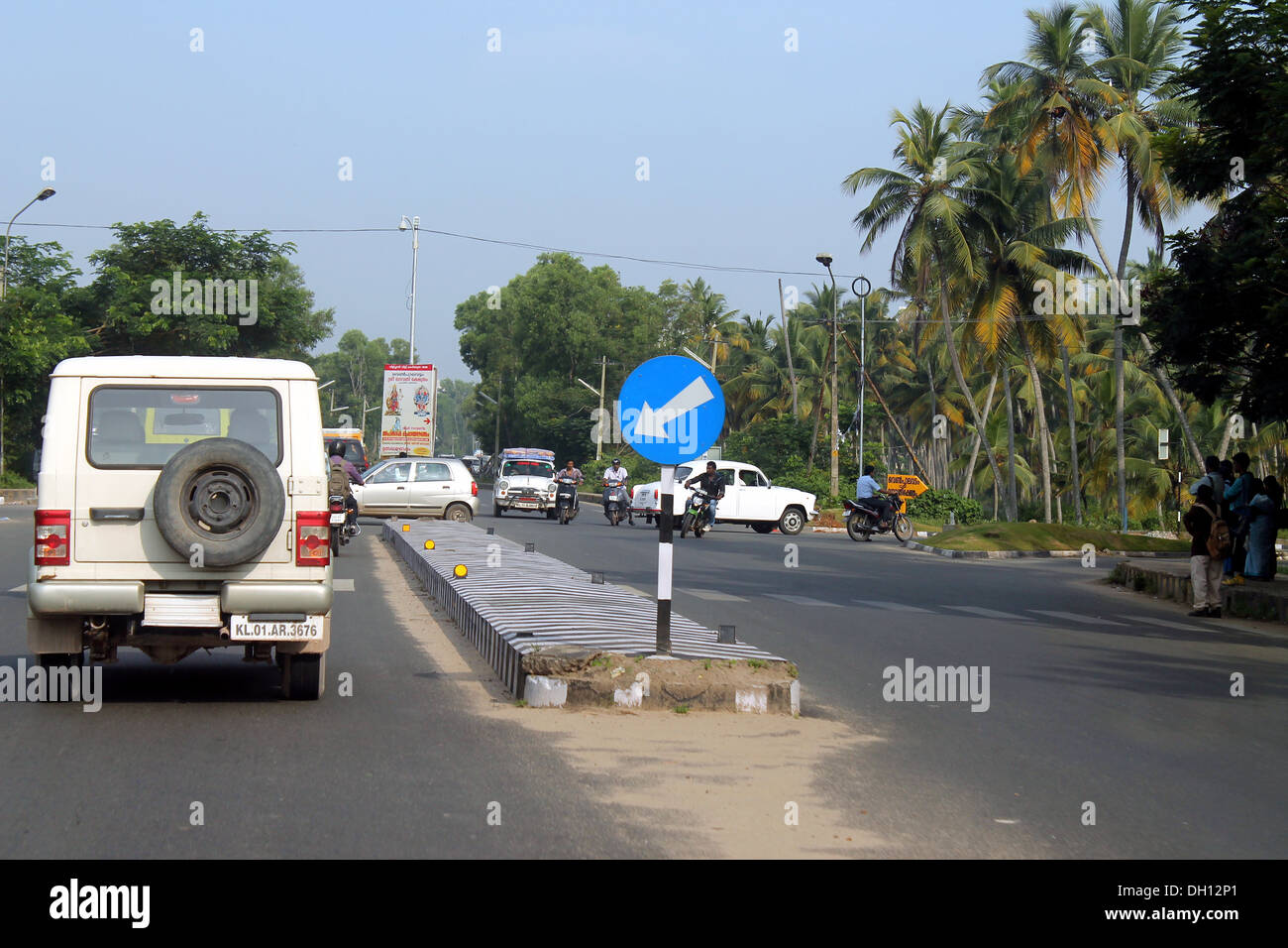 Compulsory keep left traffic sign board in Indian road - Stock Image
