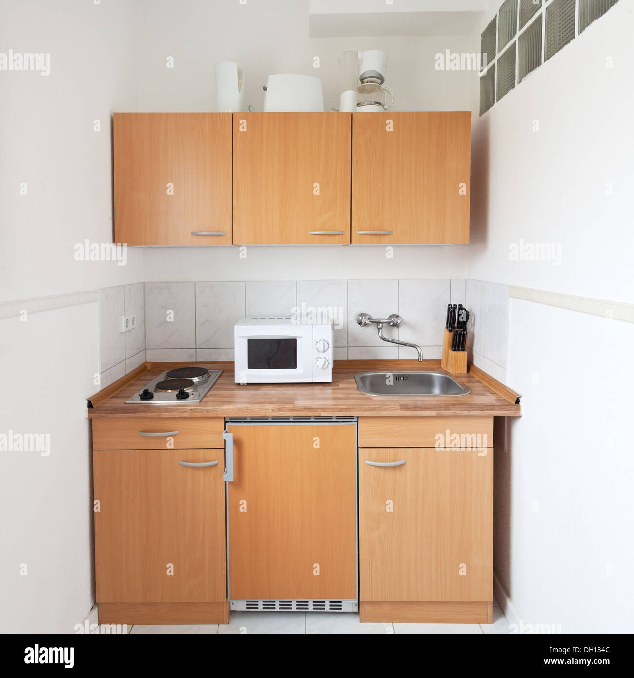 simple kitchen with furniture set and kitchen equipment ...