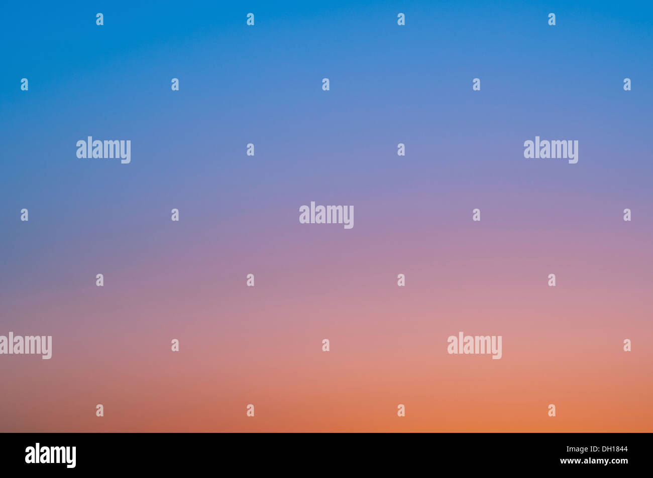 image of a cloudless sky at sunset - Stock Image