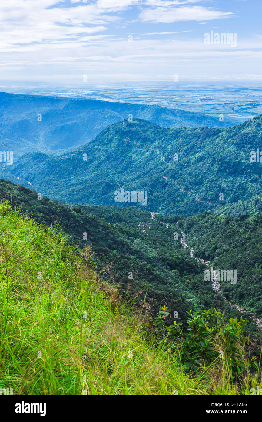 View of the beautiful Khasi Hills showing deep valleys and gorges and a glimpse of Bangladesh across the border from Meghalaya. - Stock Image