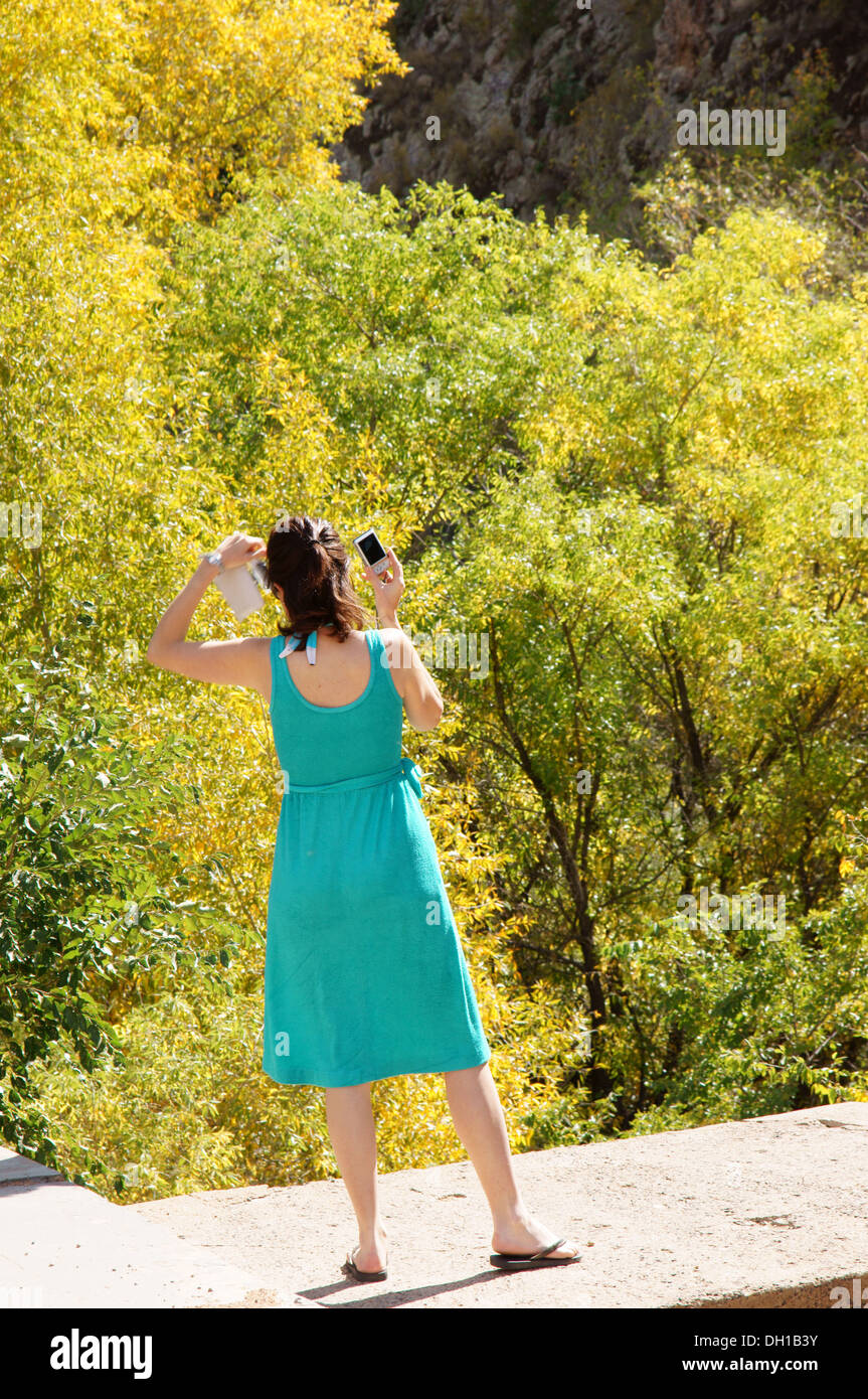 female photographer taking picture in woods outdoors adult grownup mature woman human girl she art aptitude - Stock Image