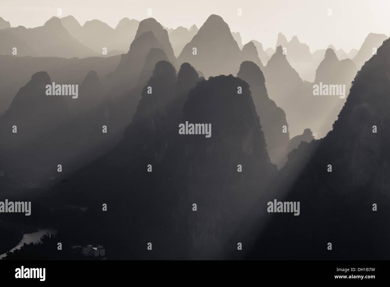 Sun rays coming through Karst peaks in China Stock Photo