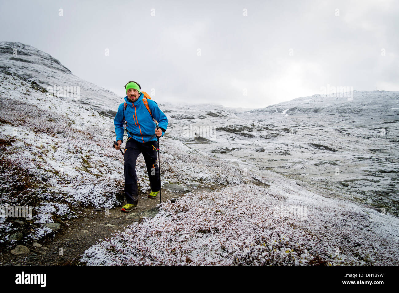 Man speed hiking along snowcapped trail, Norway, Europe - Stock Image