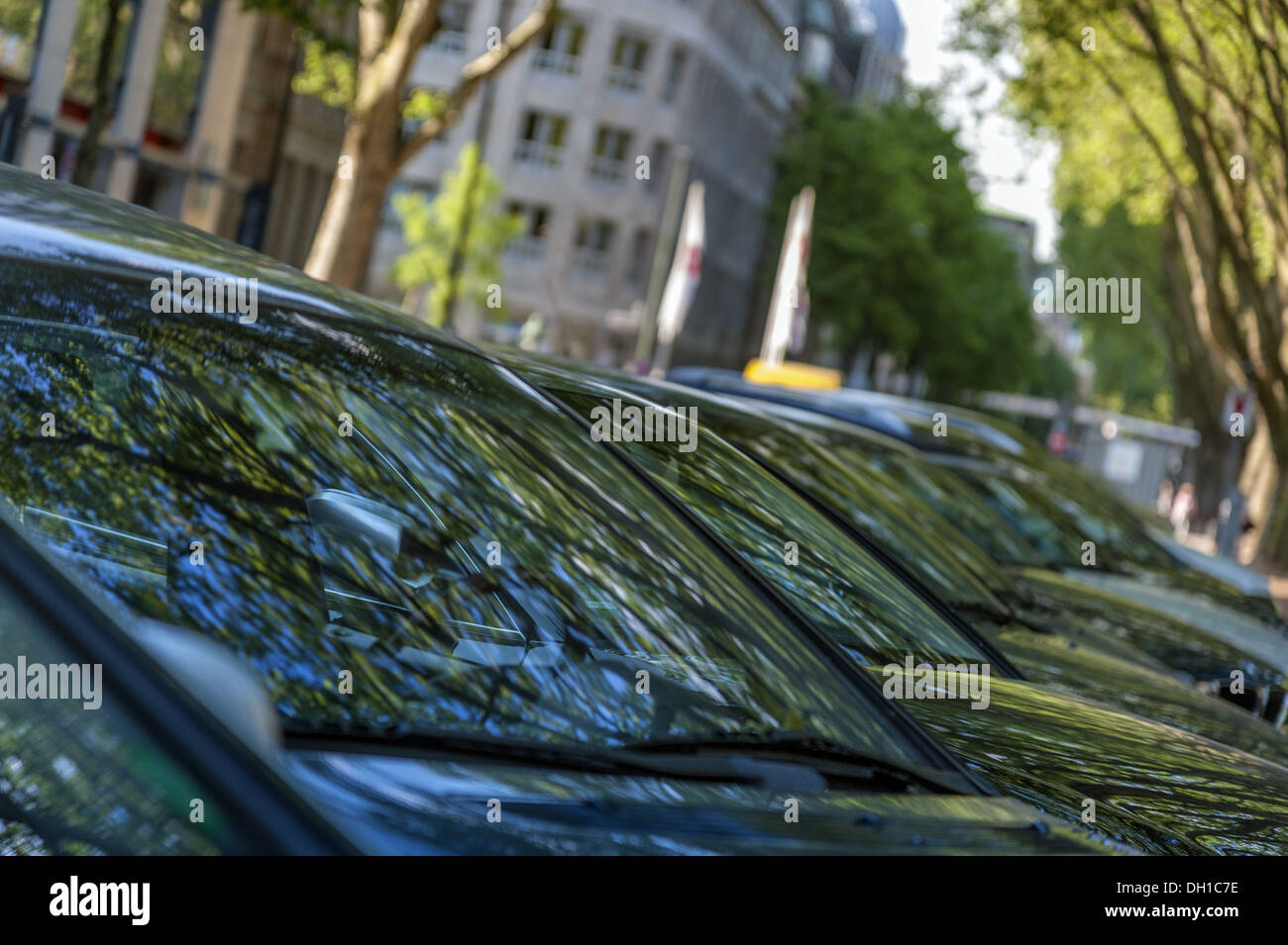 parked vehicles in series - Stock Image