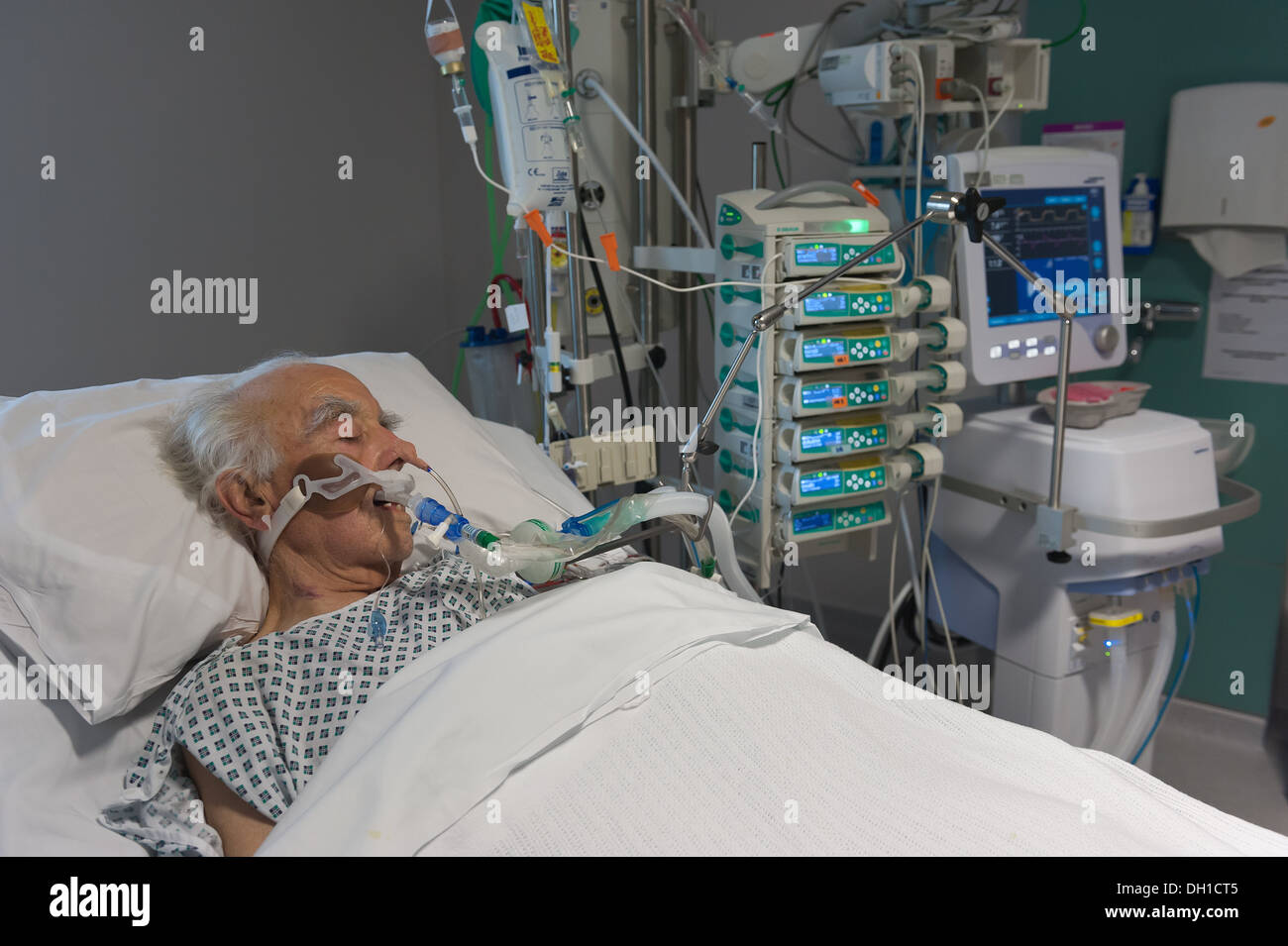 intensive care of an elderly patient on a life support machine stock