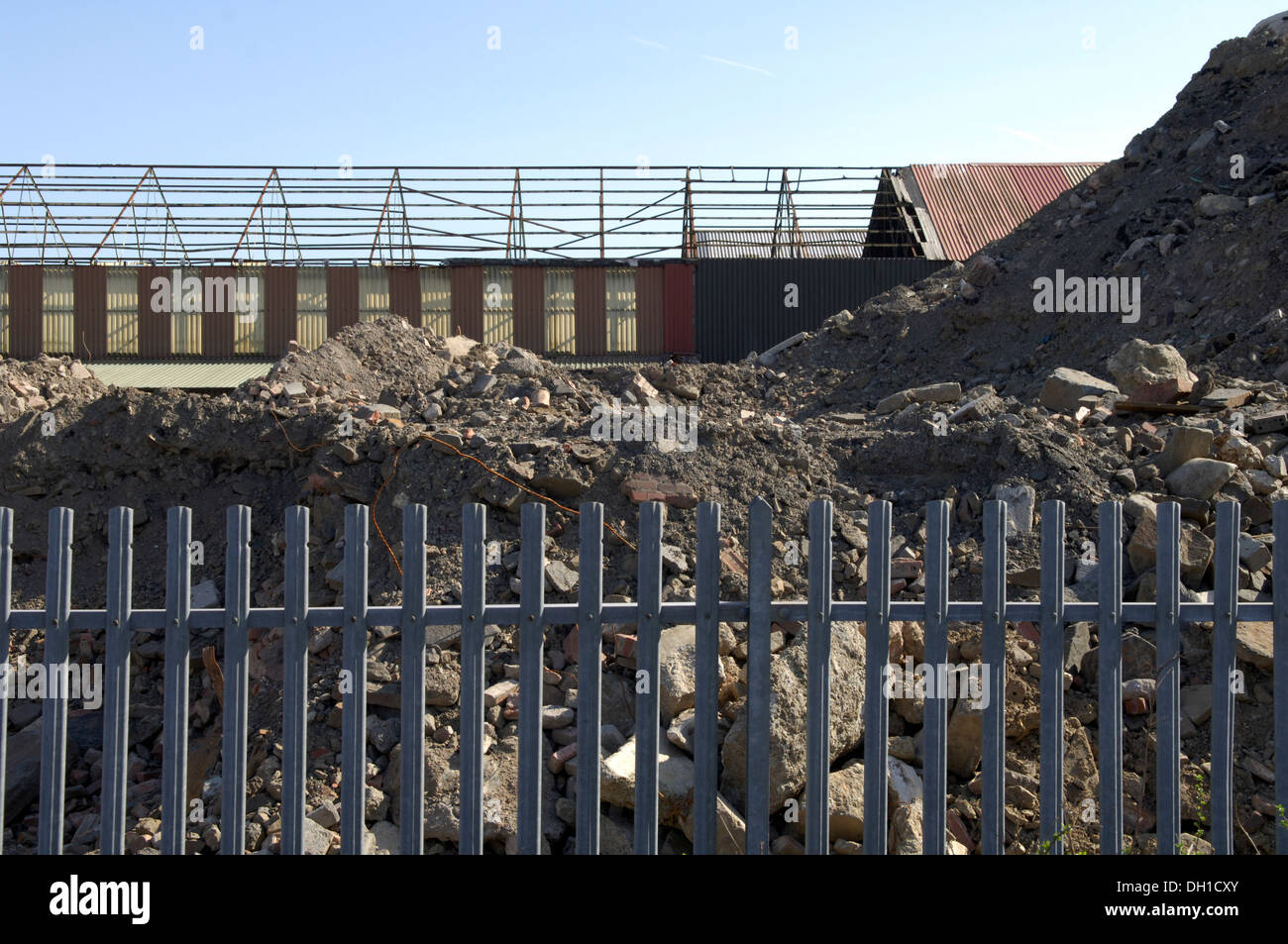 In urban planning, a brownfield site is land previously used for industrial purposes. The land may be contaminated - Stock Image