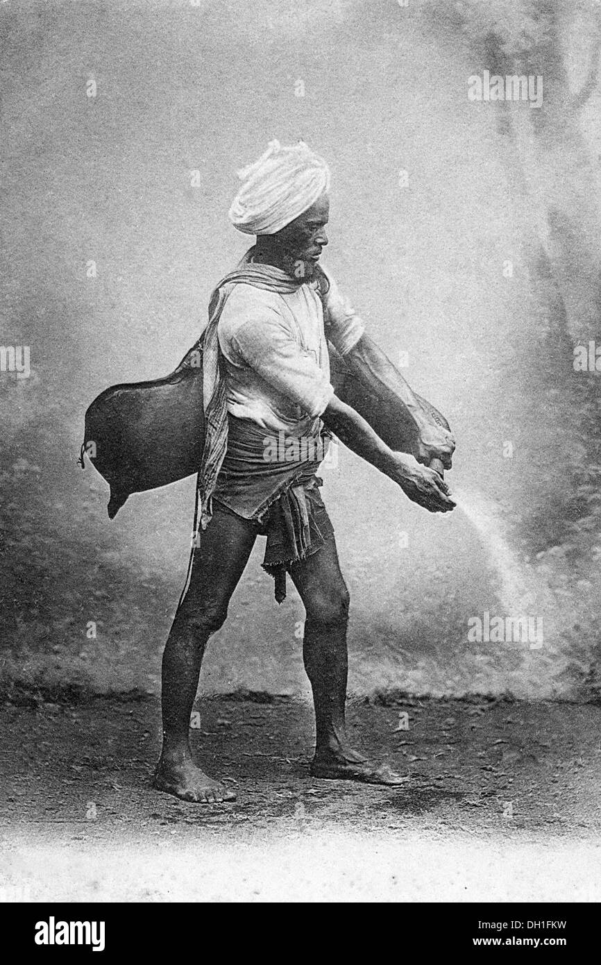Old Vintage Photo Of Indian Man Sprinkling Water From Leather Bag India