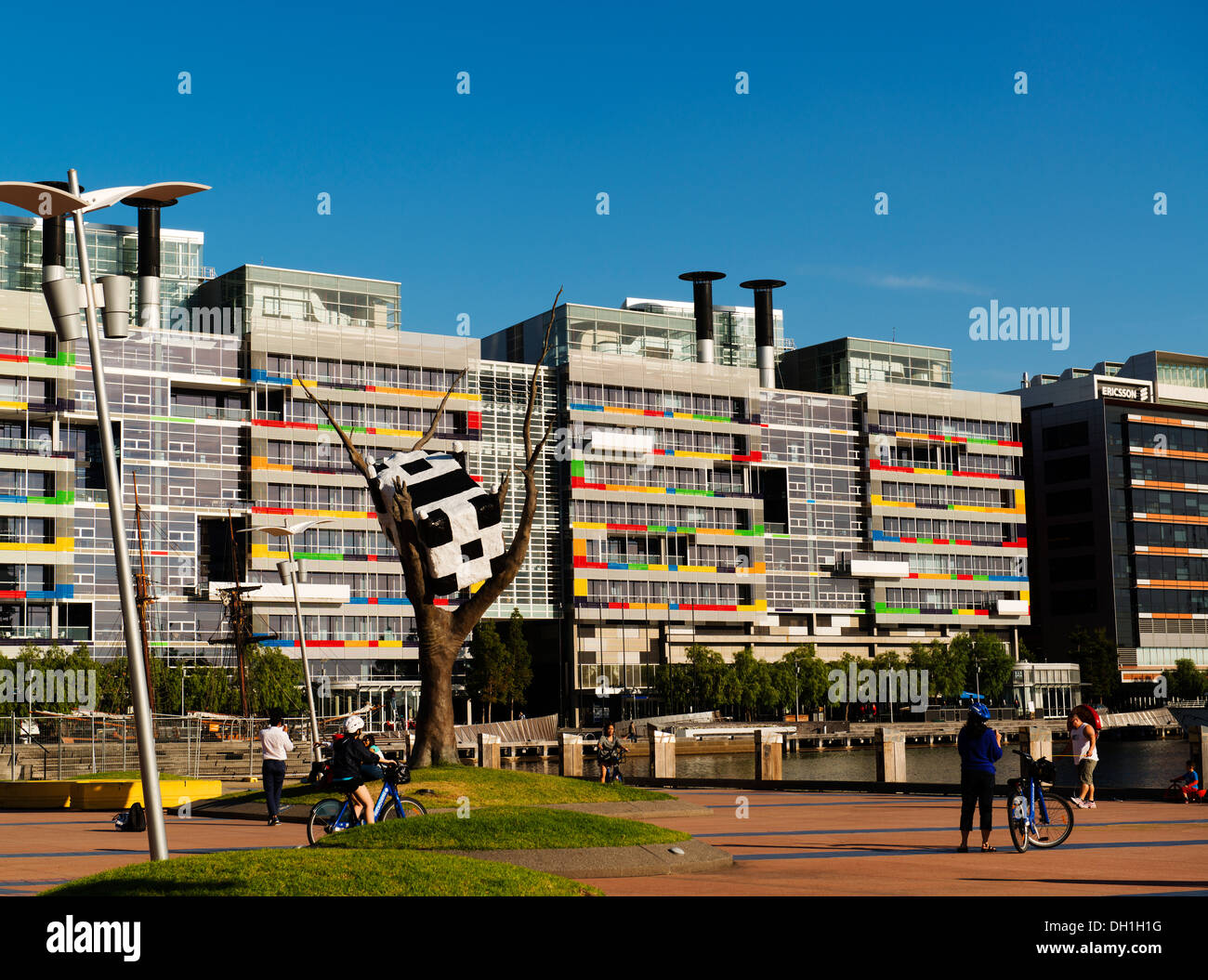Public art and mixed use buildings at Melbourne's Docklands district. - Stock Image