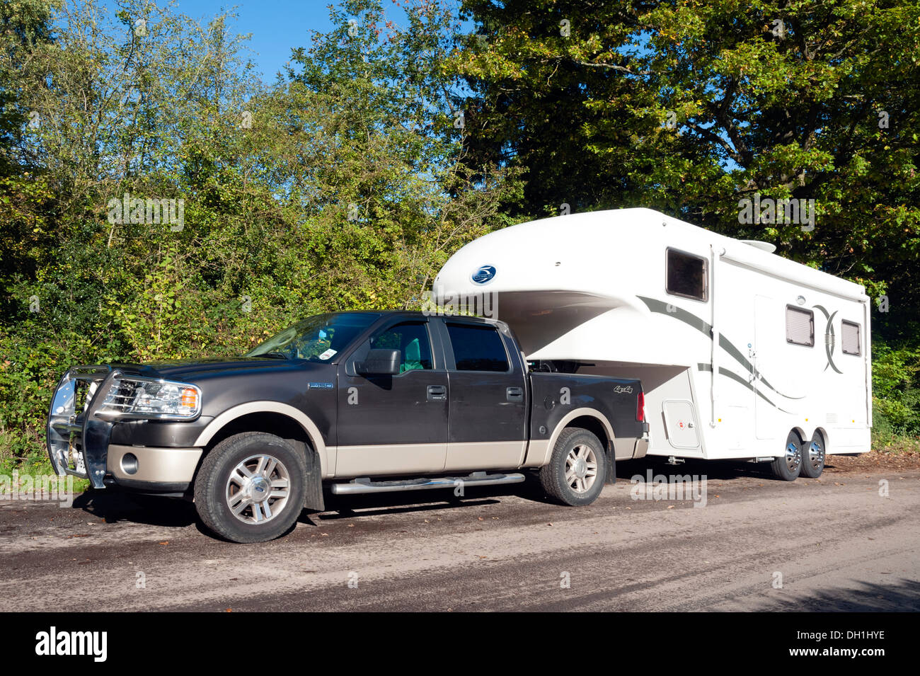 Pickup Truck With A Caravan Parked In A Rural Layby Uk