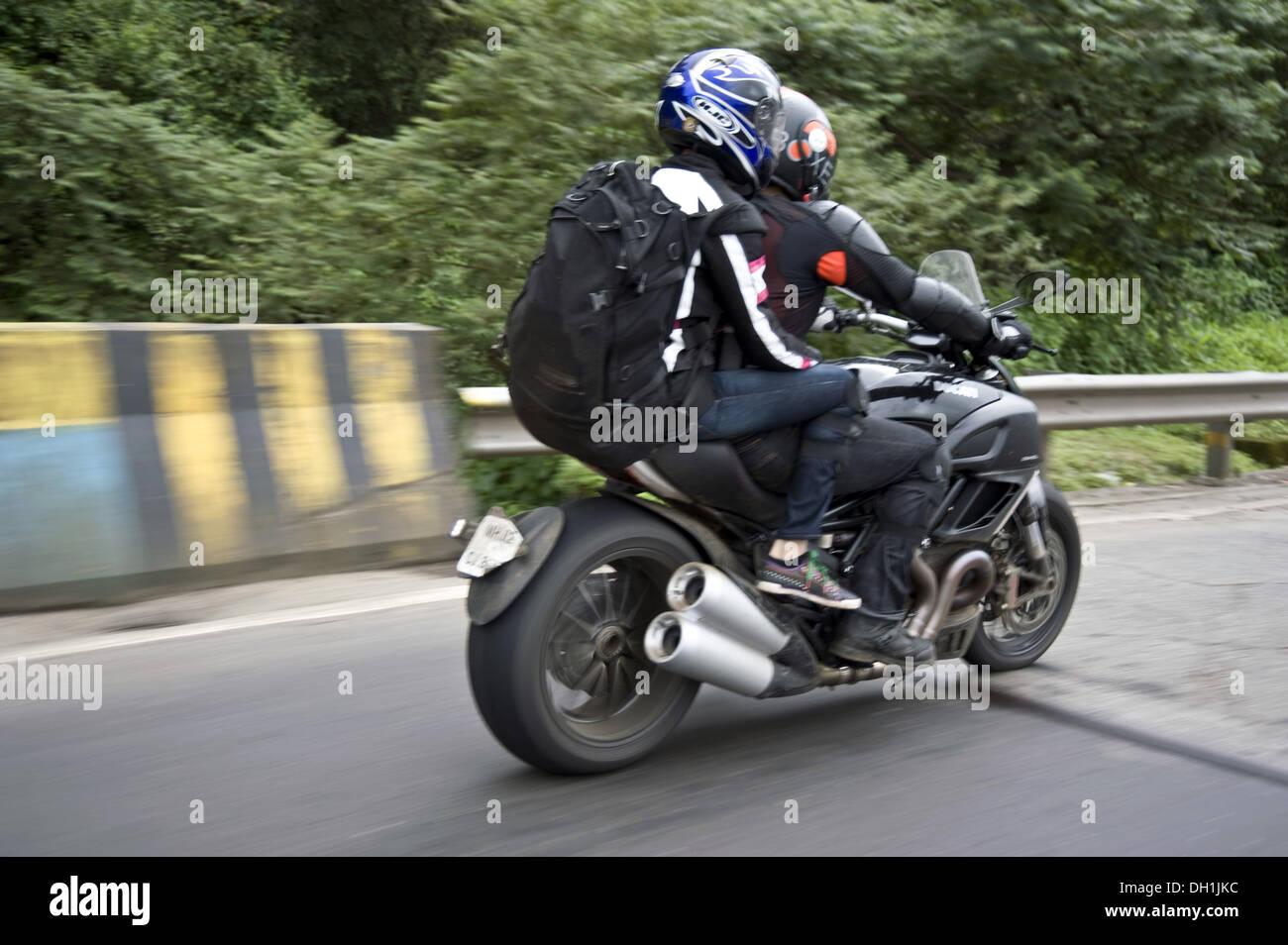 two men on sport ducati bike on Mumbai Pune expressway Maharashtra India Asia - Stock Image