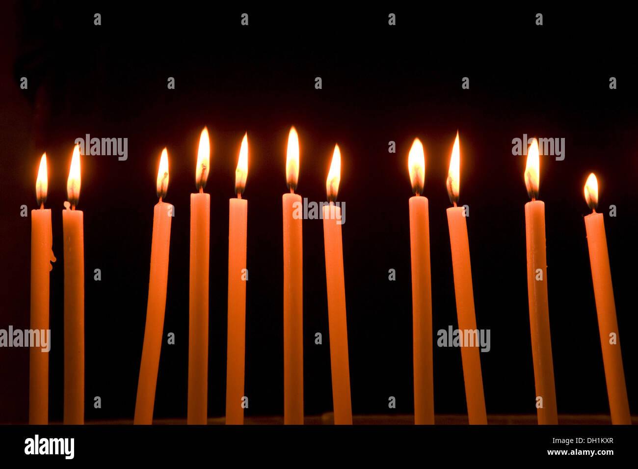 eleven burning candles - Stock Image