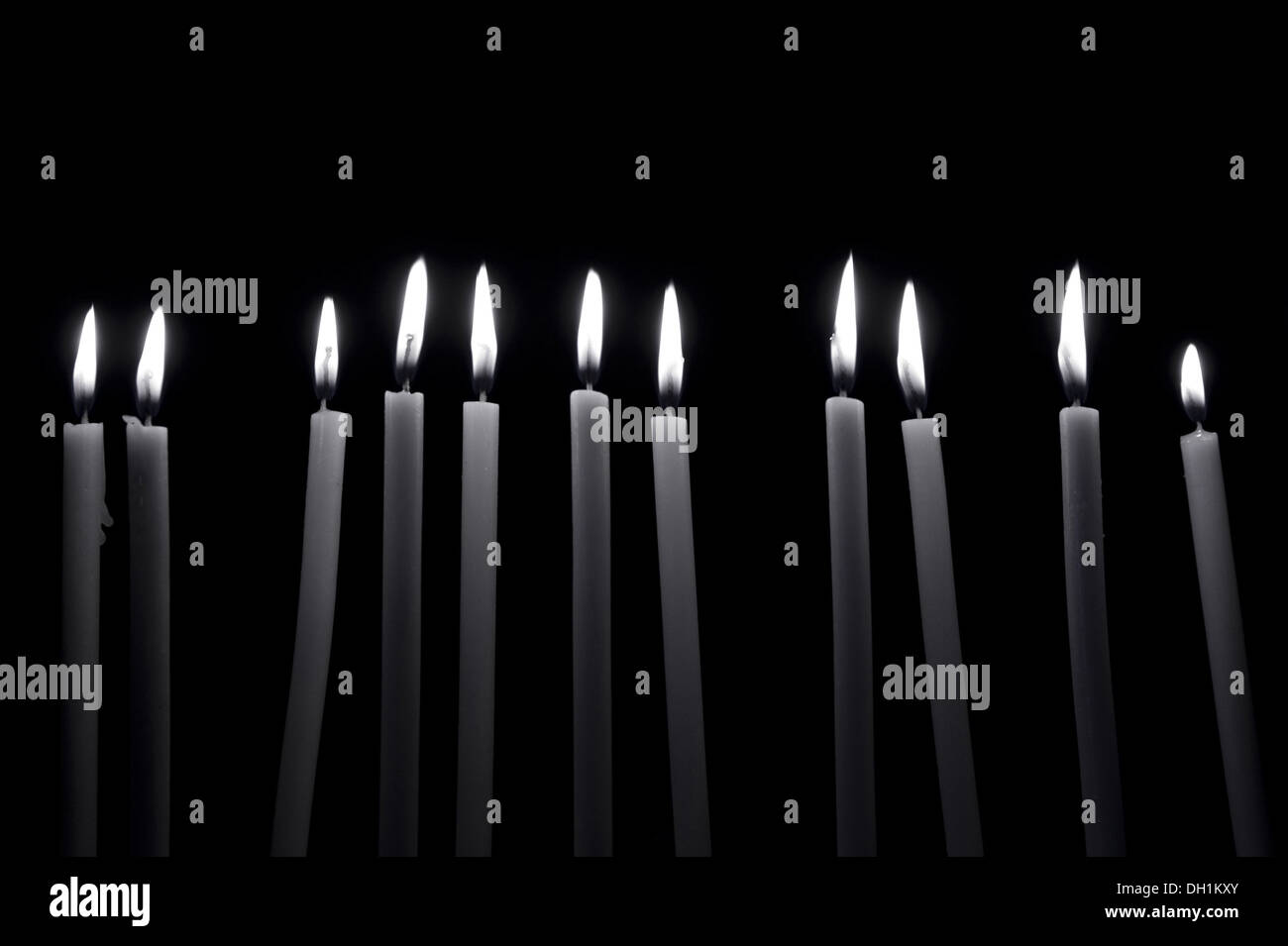 eleven candles burning flame - Stock Image