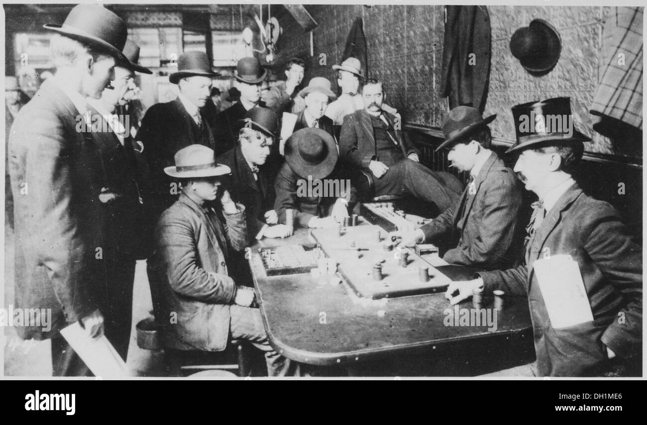 Orient Saloon at Bisbee, Arizona... Faro game in full blast. Recognized, Left to right-Tony Downs (standing with - Stock Image