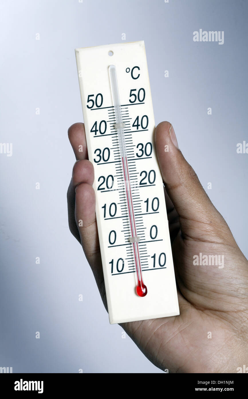 temperature meter showing 35 degrees celsius Close up of Temperature meter holding in hand MR#743AB - Stock Image
