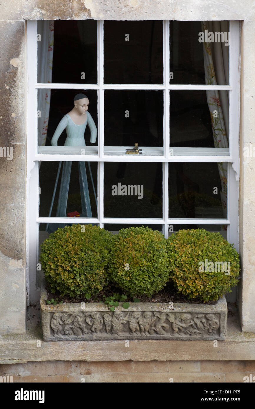 figure in window of terrace house in Royal Crescent at Bath in April - Stock Image