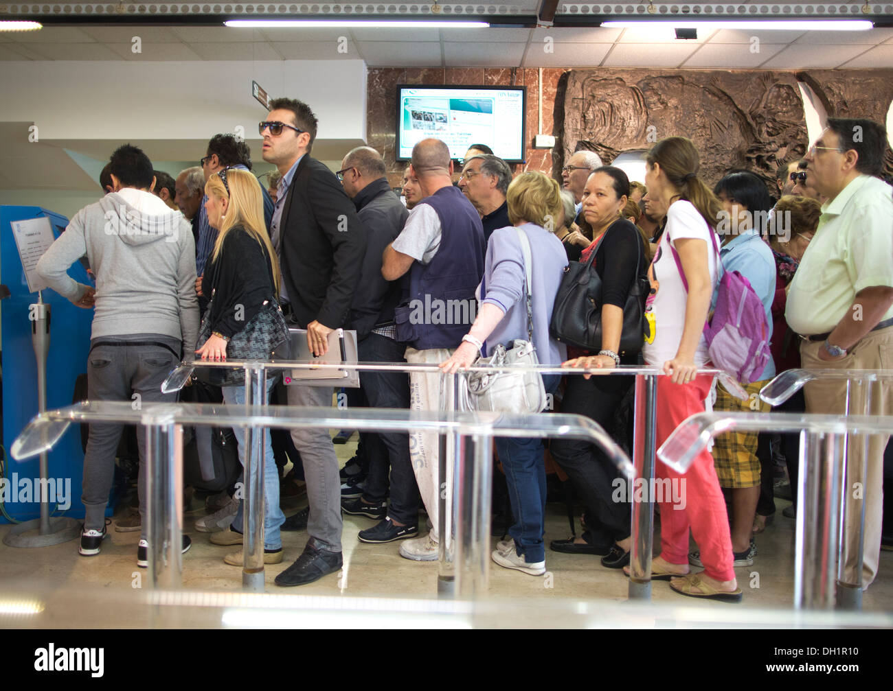 Civilians queuing at the Palermo Unemployment and Pensions Centre, in the centre of the capital of Sicilia. - Stock Image