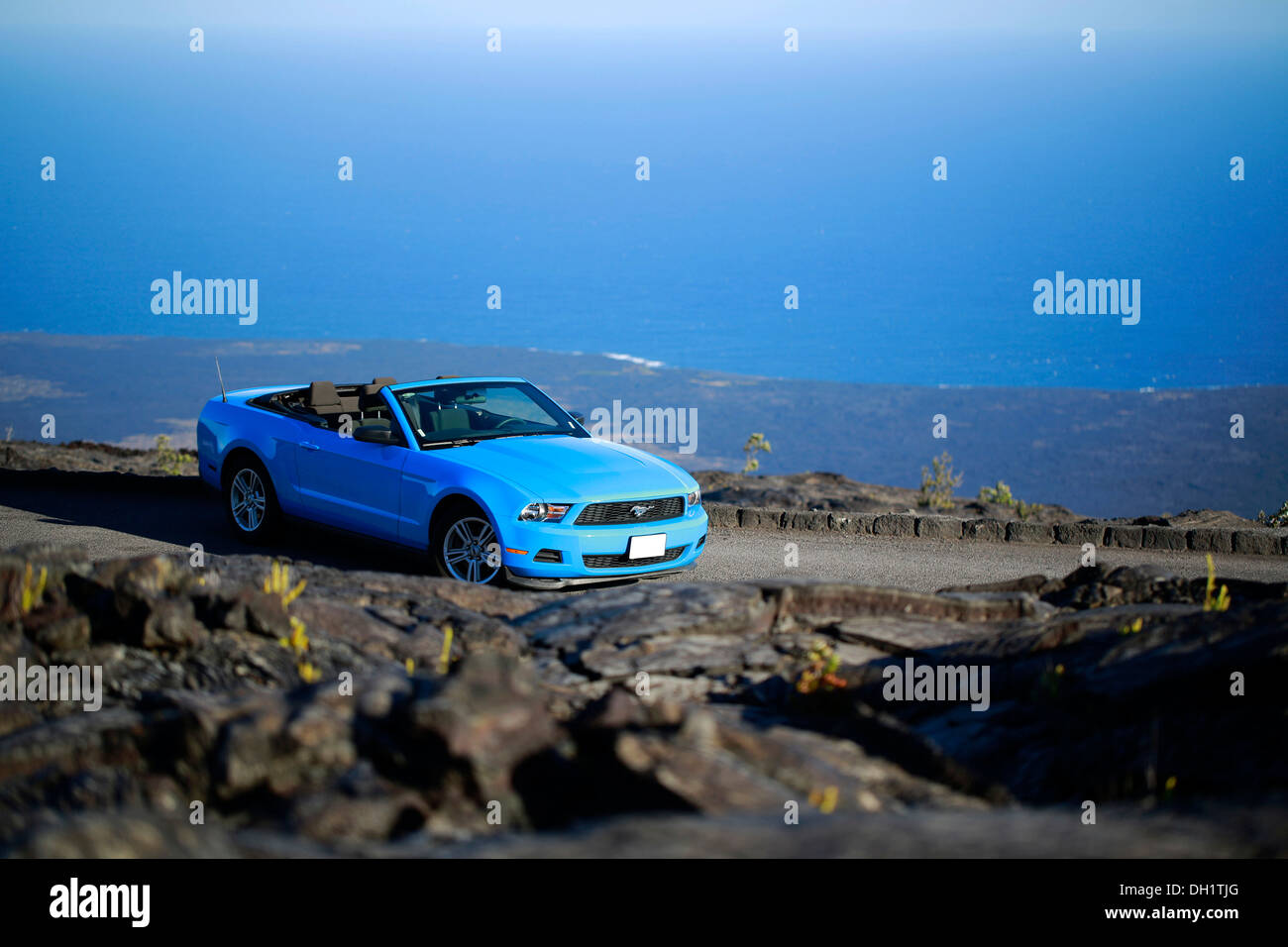 Sky-blue Ford Mustang convertible by the sea, Big Island, Hawaii, USA - Stock Image
