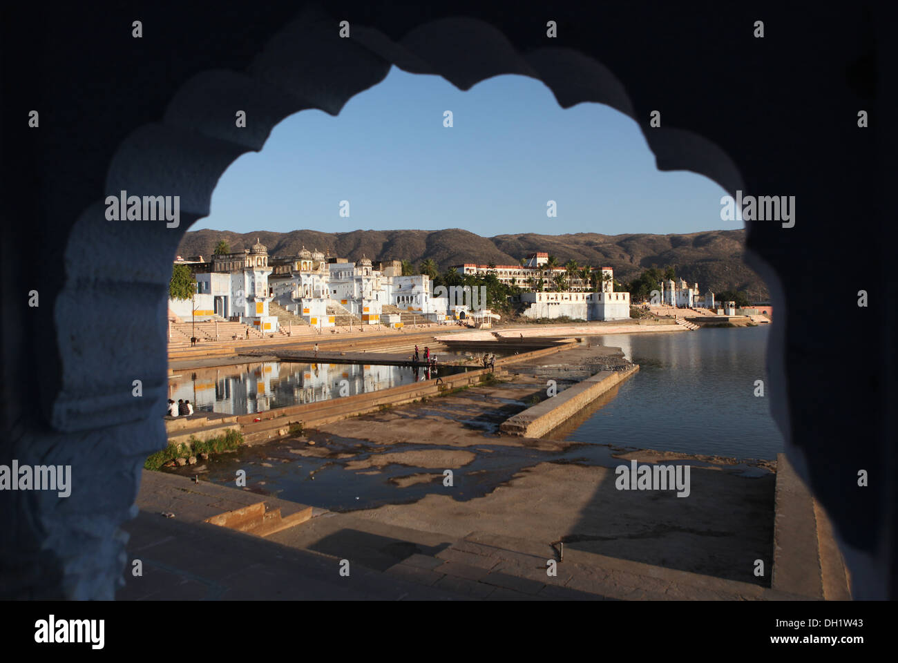 View across a ghat towards the holy city of Pushkar, Rajasthan, India, Asia - Stock Image