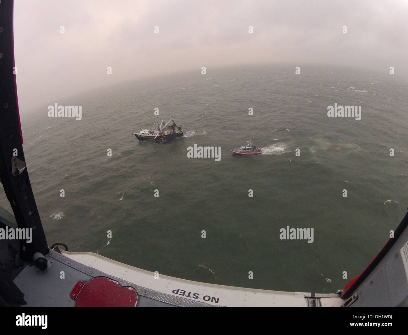 A Coast Guard boatcrew aboard a 45-foot Response Boat - Medium from Station Mayport in Atlantic Beach, Fla., is on scene 2 miles off Ponte Vedra, Fla., with the 88-foot shrimp boat Sea King, which began taking on water with four people aboard Tuesday, Oct - Stock Image