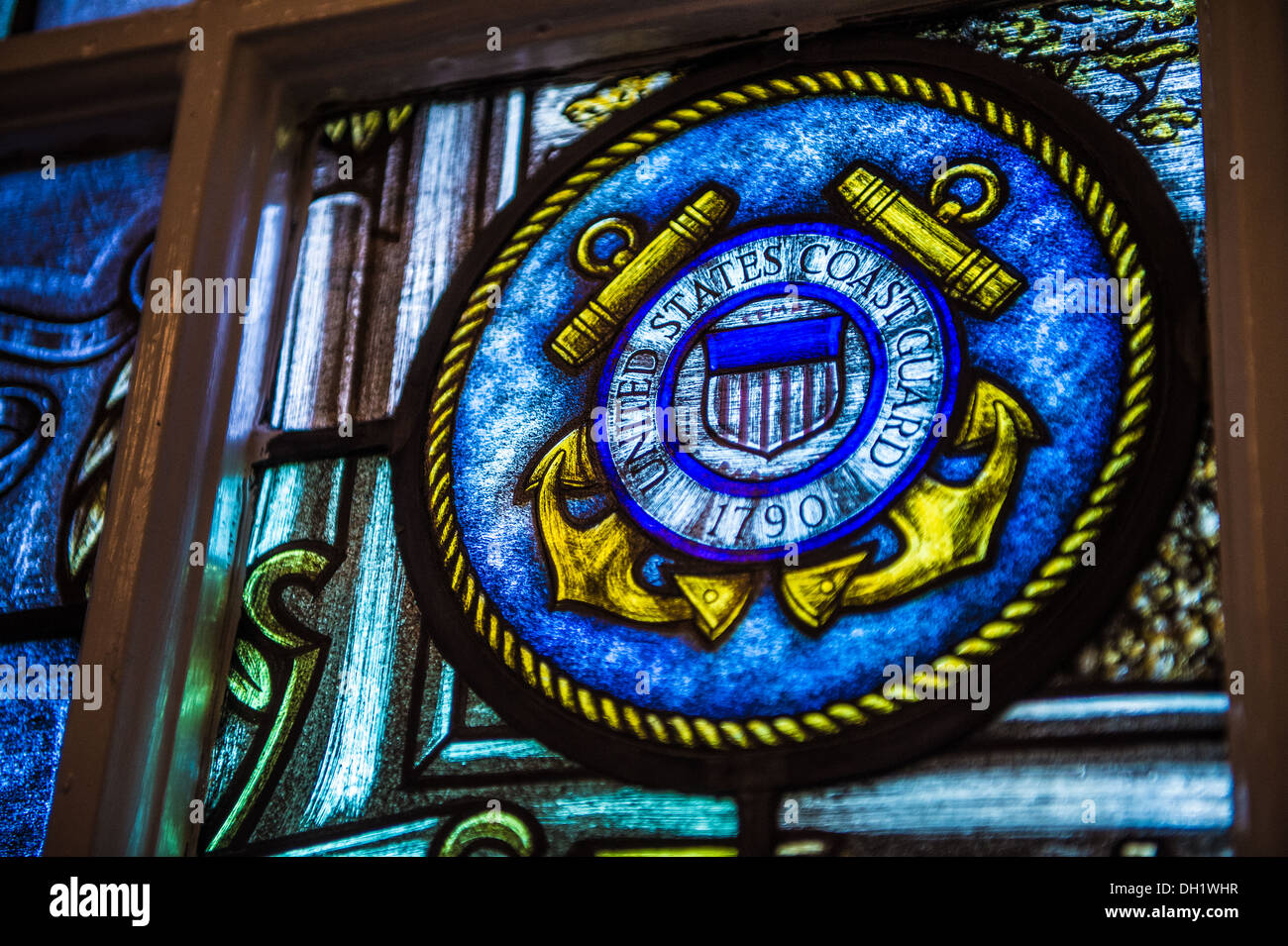 The Coast Guard seal is shown on as it appears on a stained-glass window located inside the Old Post Chapel at the Arlington National Cemetary Tuesday, Oct. 15, 2013. The chapel was built in 1934. - Stock Image