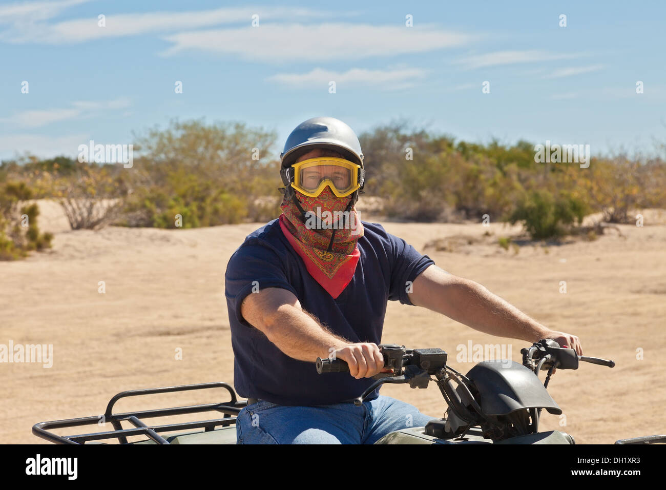 Male ATV Driver riding in the desert of Cabo San Lucas, Mexico - Stock Image