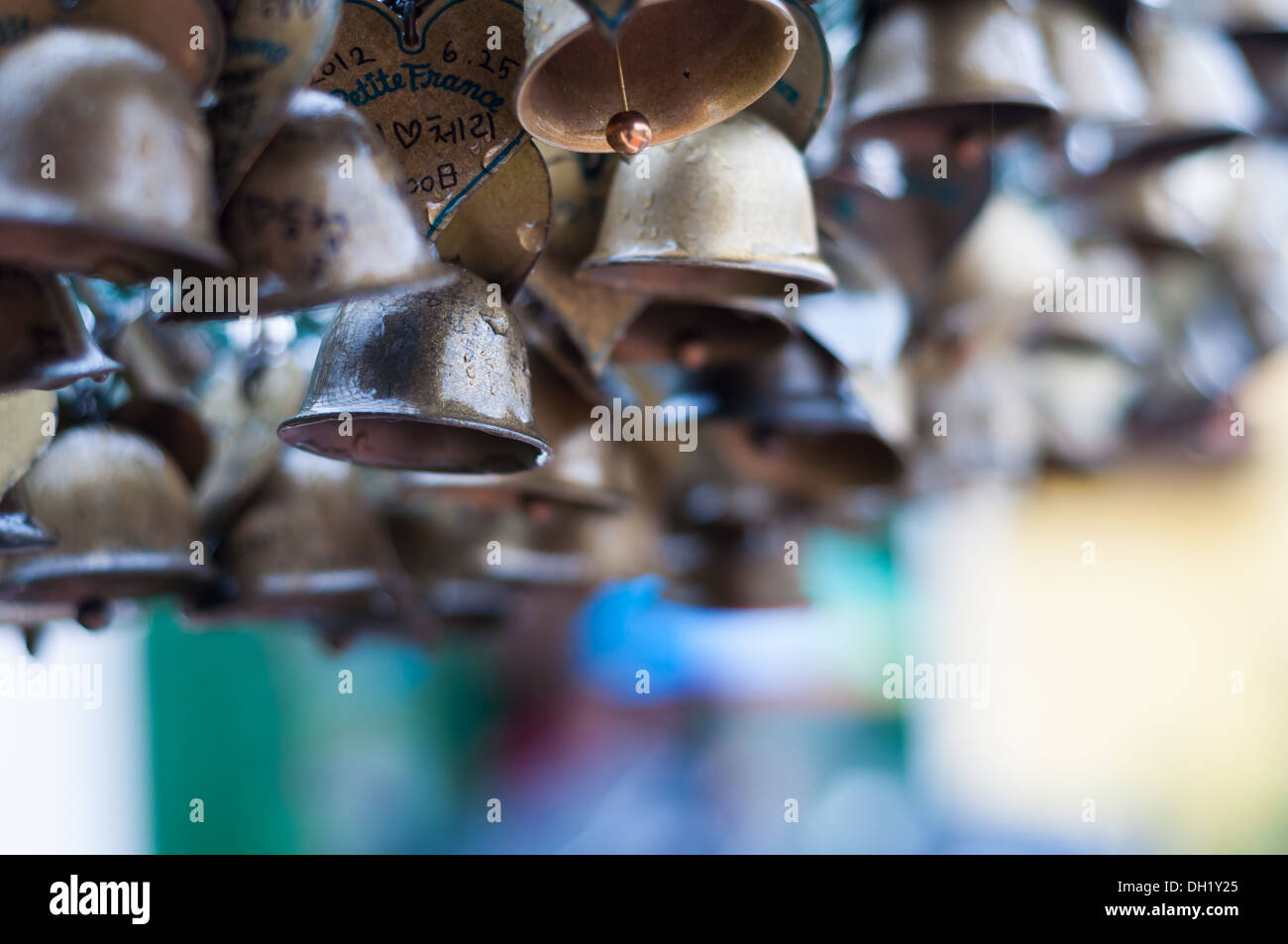 Bells hanging in the rain. - Stock Image