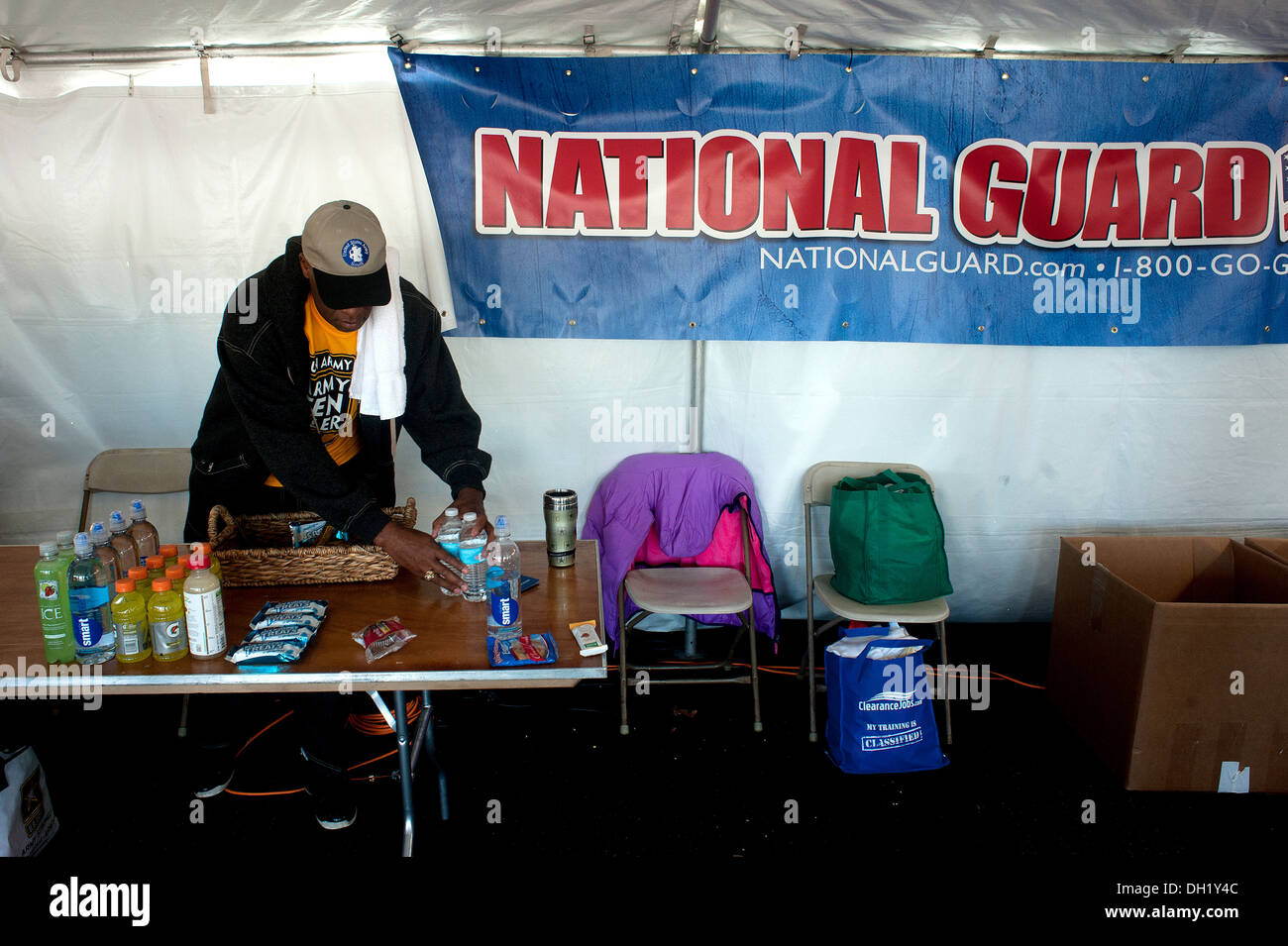 A Soldier from the Army National Guard Readiness Center stock items in the National Guard tent at the 29th annual Army 10-Miler - Stock Image