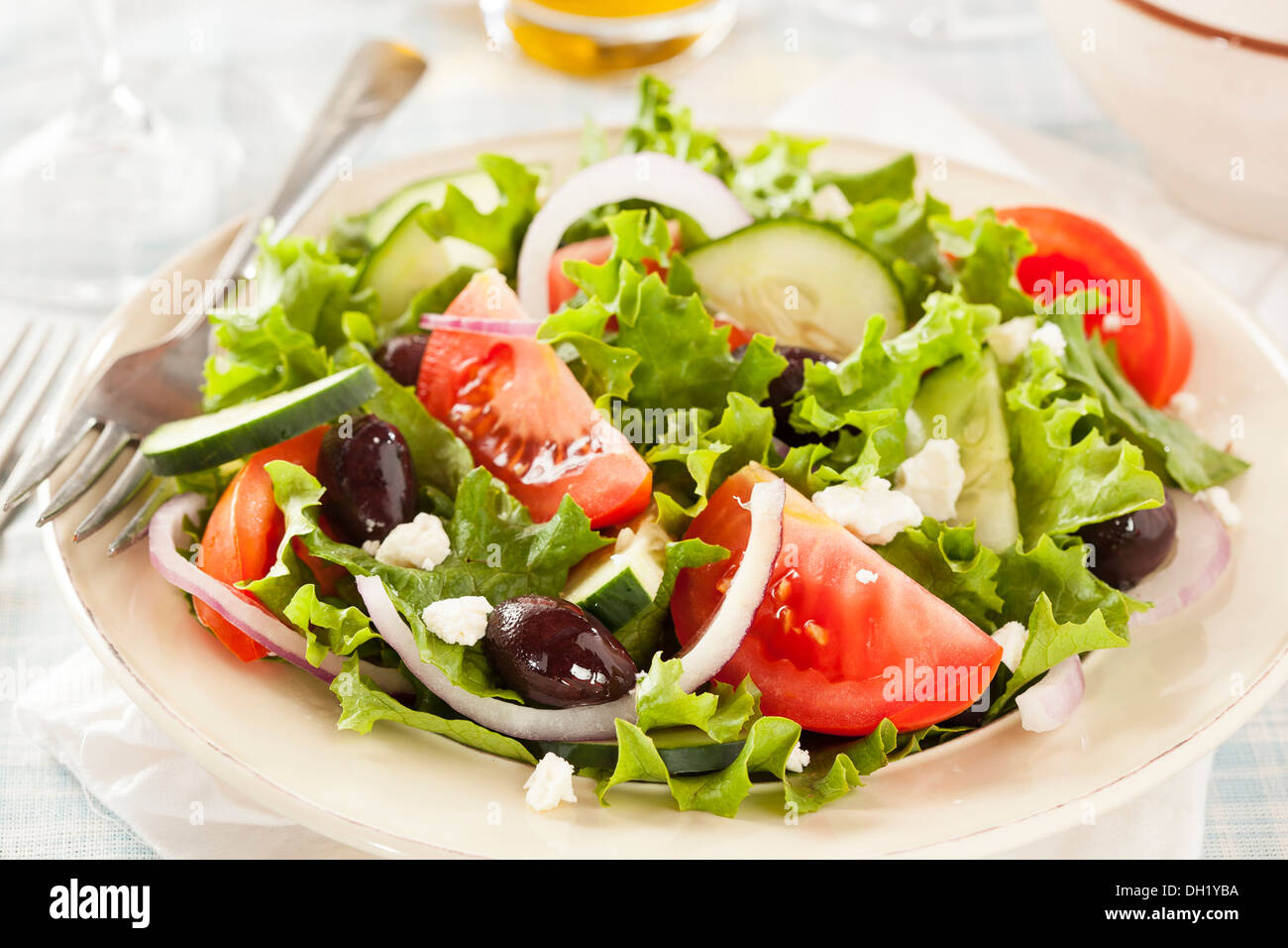 Homemade Organic Greek Salad with Tomato, Olives, and Feta Cheese Stock Photo