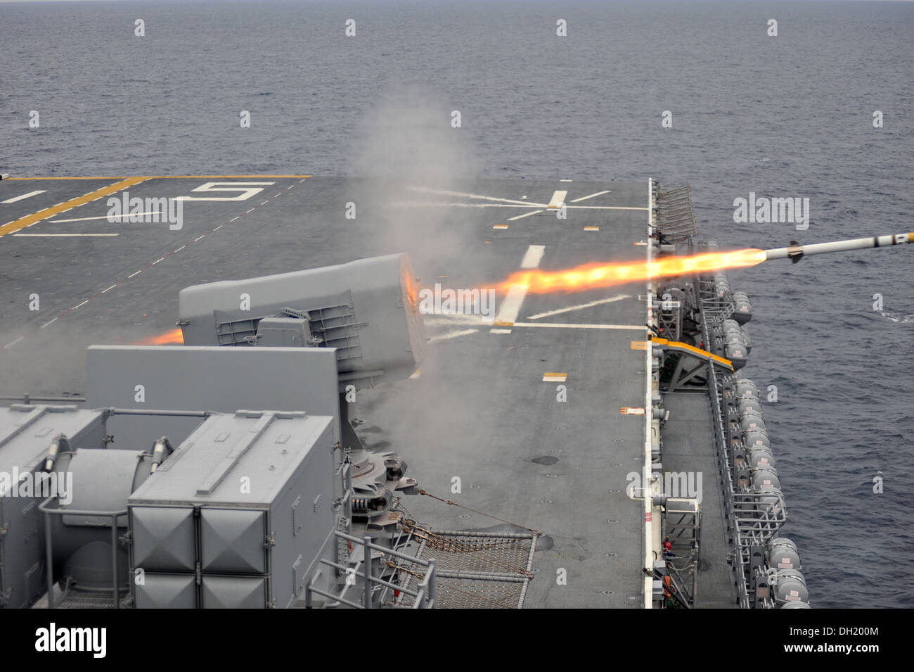 USS Bataan sailors fire a RIM-116 Rolling Airframe Missile (RAM). The RAM provides ships with self-defense system against anti-ship missiles and asymmetric air and surface threats. The multipurpose amphibious assault ship USS Bataan (LHD 5) and 22nd Marin - Stock Image