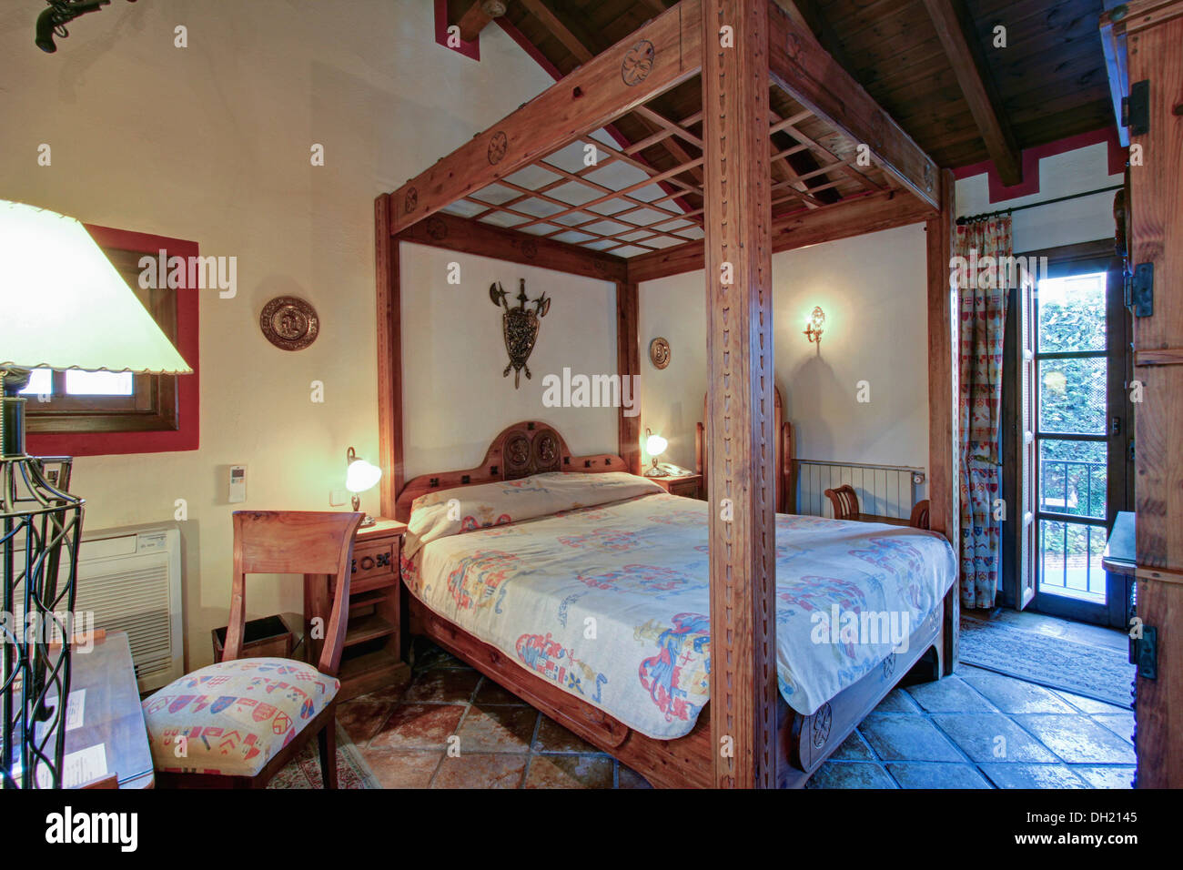 Rustic Wooden Four Poster Bed In Bedroom In Spanish Country Villa Stock Photo Alamy