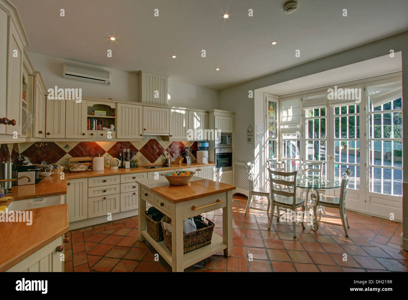 Butchers block in country style Spanish kitchen with terracotta