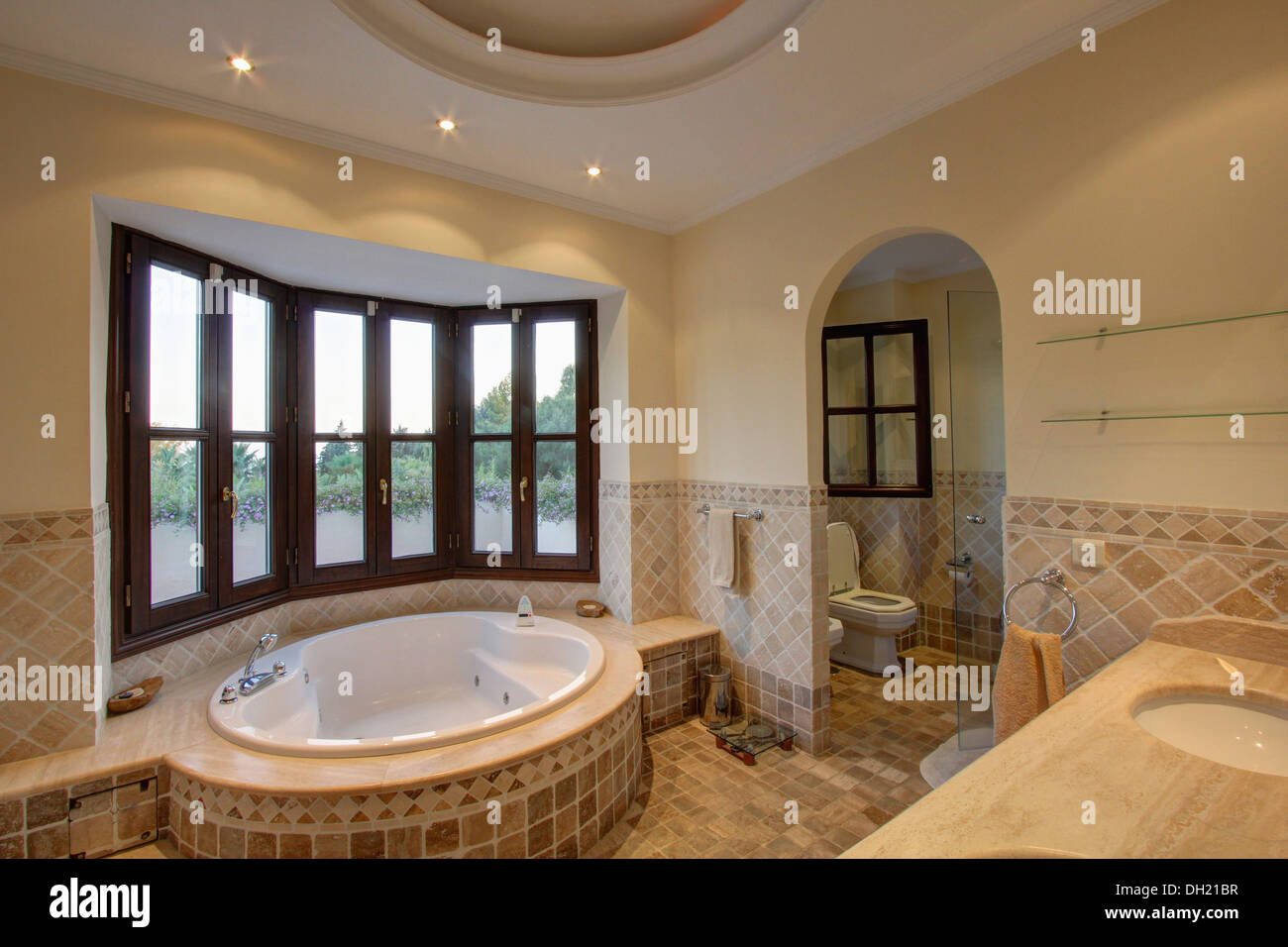 Oval Spa Bathtub Below Bay Window In Modern Spanish Bathroom With Stock Photo Alamy