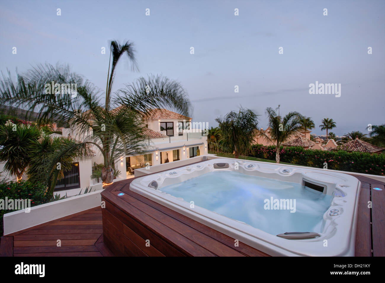 Hot tub on raised, decked terrace in grounds of large villa in Stock ...
