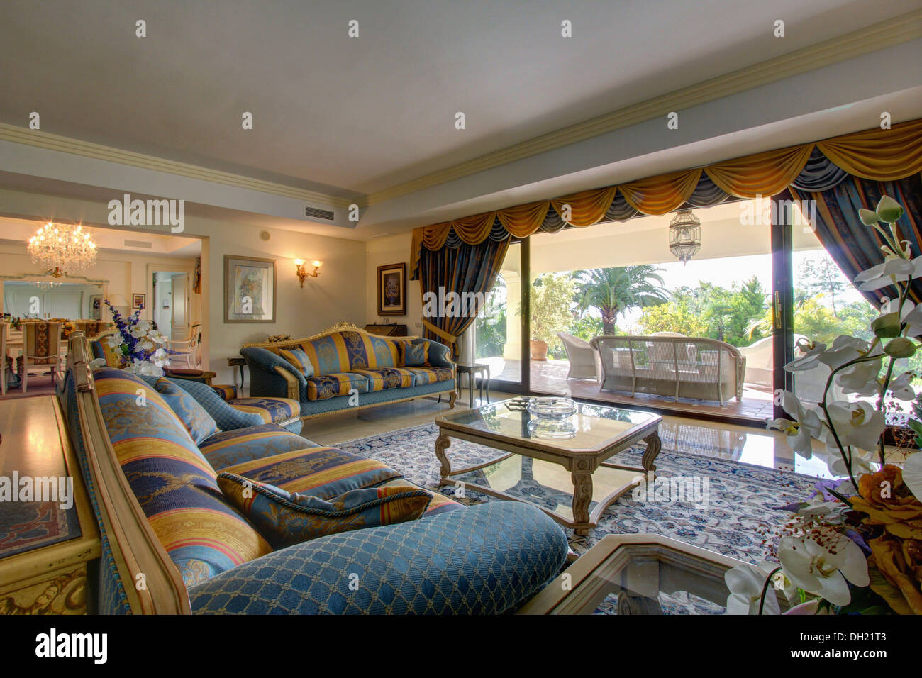 Yellow+blue Patterned Sofa And Matching Drapes On Glass Doors In Spanish  Living Room With