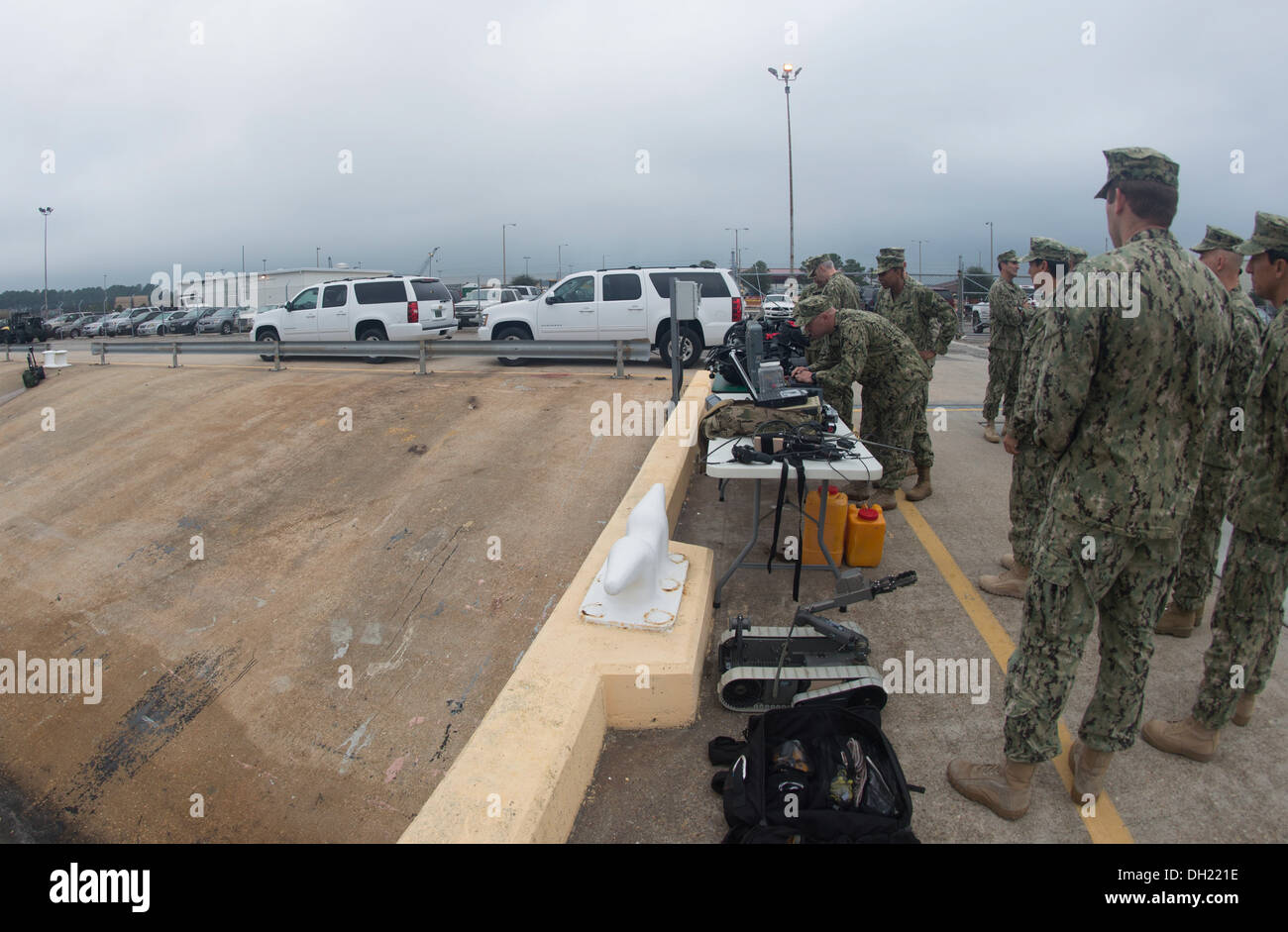 Sailors from Explosive Ordnance Mobile Unit 12 (EODMU 12) present a mine countermeasure demonstration to Vice Adm. William Moran, chief of naval personnel. U.S. Navy EOD is the world's premier combat force for countering explosive hazards and conducting e - Stock Image