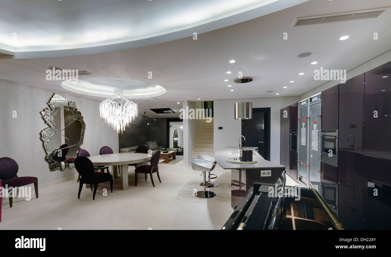 Large Open Plan Kitchen And Dining Room With Lighted False Ceiling White Flooring In Modern Apartment Southern Spain