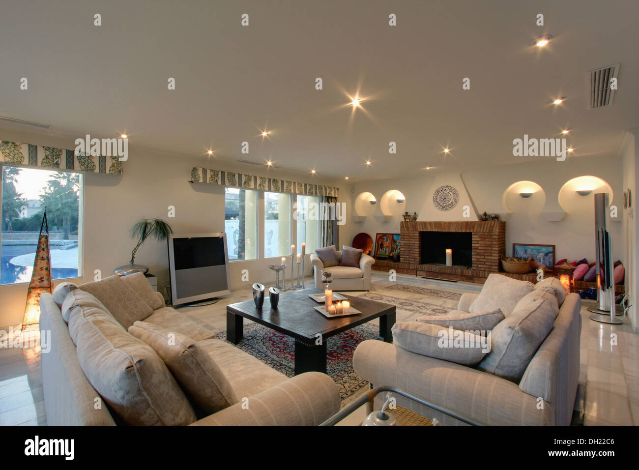 Beige Sofas And Low Table In Modern Living Room With Large Television In  Well Lit Living Room Of New Build Spanish Villa