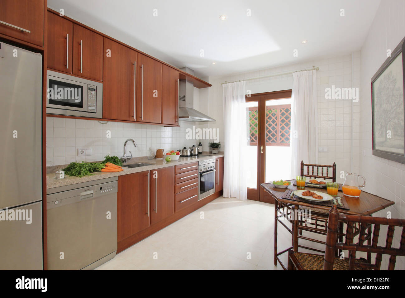 Breakfast On Table In Modern Spanish Kitchen With Stainless Steel - Stainless steel dishwasher table
