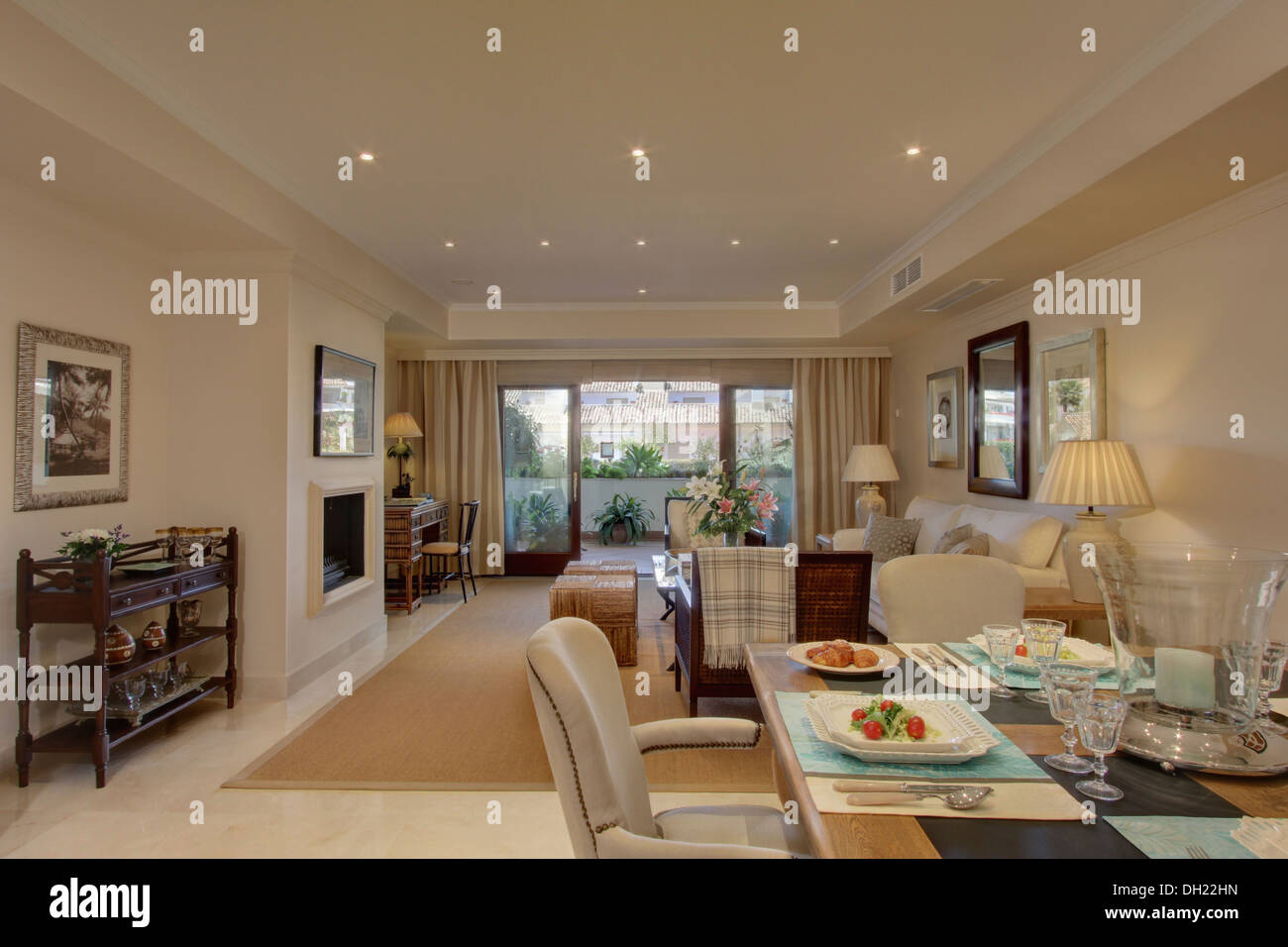 Table set for lunch in dining area of open plan living for Living room setups for apartments