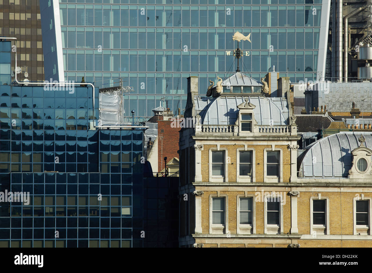 The old Billingsgate building from the south bank of the river Thames with city buildings in the background. - Stock Image