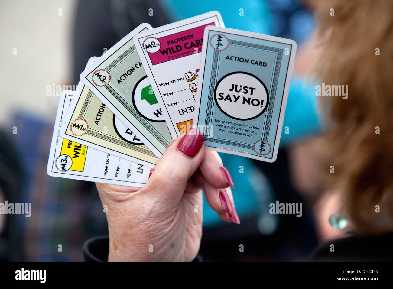 Player holding the 'just say no' action card during a Monopoly Deal board game. St Paul Minnesota MN USA - Stock Image