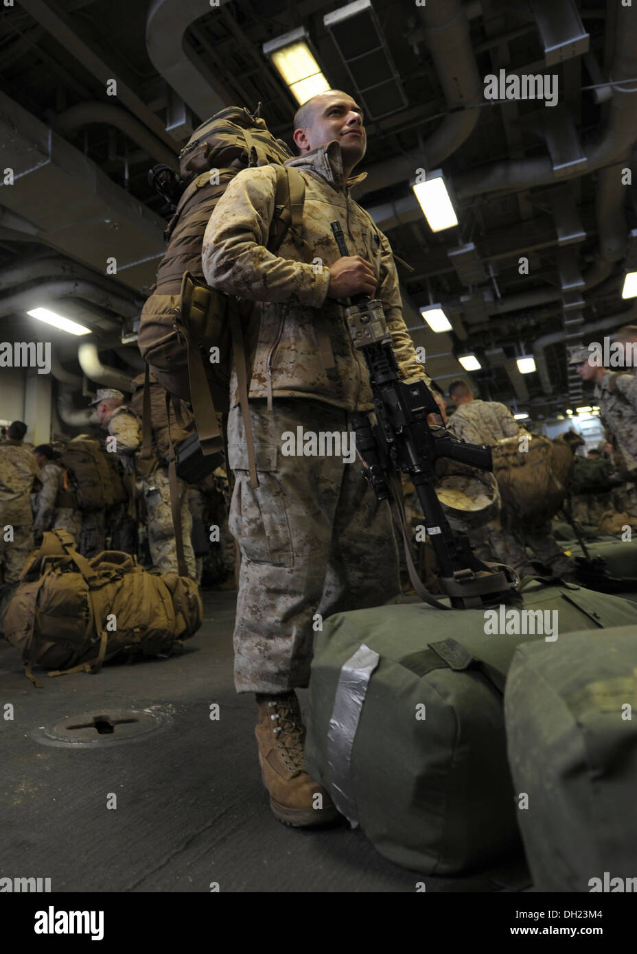 Staff Sgt. Johny Gutierrez, from Knoxville, Tenn. awaits further instructions after arriving aboard the multipurpose amphibious - Stock Image