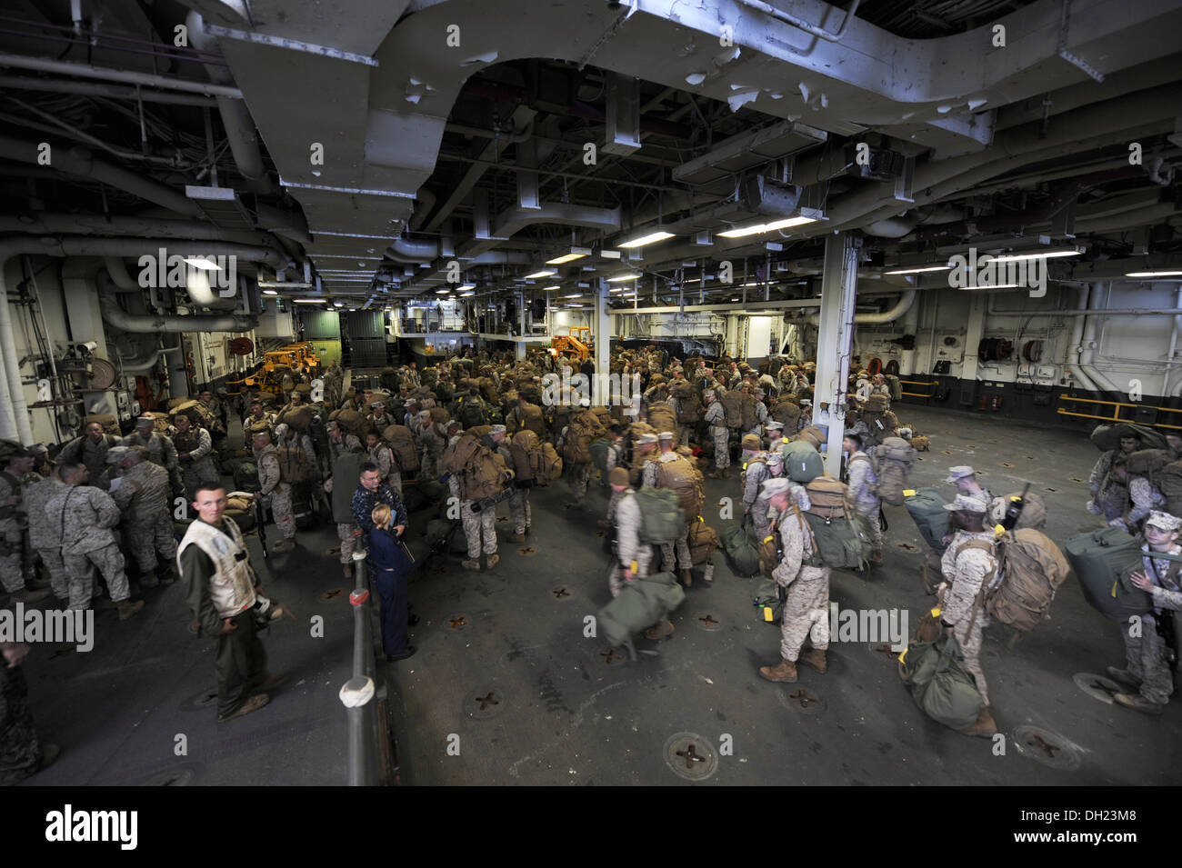 Marines await further instruction inside the well deck of the multipurpose amphibious assault ship USS Bataan (LHD 5). Bataan Sailors and 22nd Marine Expeditionary Unit Marines are underway conducting routine qualifications. - Stock Image
