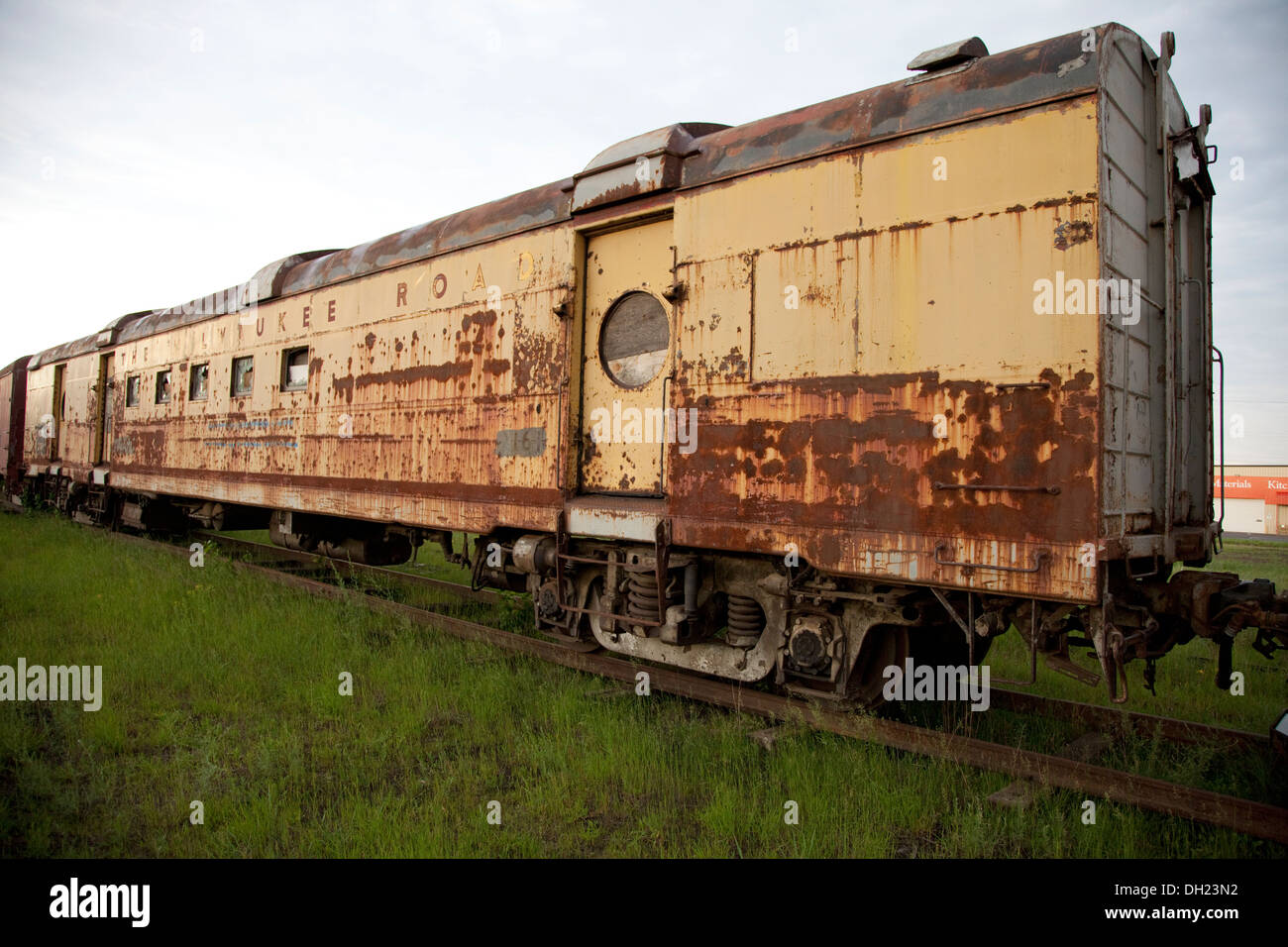 Rusted and dilapidated antique Milwaukee Road passenger car. Great Northern Railroad Spooner Wisconsin WI USA - Stock Image
